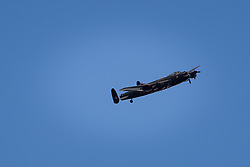© Licensed to London News Pictures . 08/10/2012 . Manchester , UK . An Avro Lancaster Bomber flying over Bury , UK , yesterday afternoon (14th September) on a Battle of Britain memorial flight . It is the only bomber of its kind left flying in the world. Photo credit : Joel Goodman/LNP