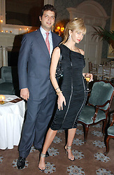 AMANDA CRONIN and PRINCE CASIMIR ZU SAYN-WITTGENSTEIN-SAYN at a dinner hosted by Krug champagne at Claridge's, Brooke Street, London on 14th February 2006.<br />