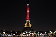 Mar 22, 2016 - Paris, France - The Eiffel tower lit with the colours of the Belgian flag in memory of the terror attack in Brussels<br />