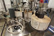 The bottle labeler machine at Stumpy's Distillery.