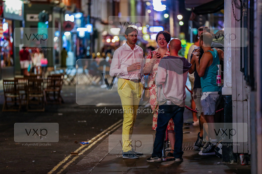 """General view of people enjoying a late night out in Soho, in London's West End on Sunday, Sept 13, 2020. The public has been urged to act """"in tune"""" with Covid-19 guidelines before the """"rule of six"""" restrictions come into force on Monday. The British government's scientific advisory board announced on Friday that the reproduction number of coronavirus transmission across the UK was now over 1.0. The Science and the Scientific Advisory Group for Emergencies (SAGE) said the R-value was now between 1.0 and 1.2. (VXP Photo/ Vudi Xhymshiti)"""