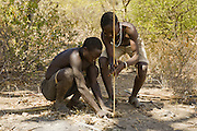Africa, Tanzania, members of the Datoga tribe light a fire