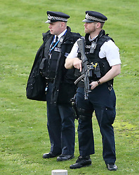 © Licensed to London News Pictures. 26/11/2015. London, UK. Armed police at the scene . A group of Airport expansion activists cause traffic chaos by blocking off the inbound tunnel of Heathrow airport in London to protest against airport expansion.  Photo credit: Peter Macdiarmid/LNP