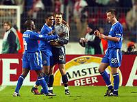 Photo: Scott Heavey.<br /> VFB Stuttgart v Chelsea. Champions League Quarter Final First Leg. 25/02/2004.<br /> The Chelsea team celebrate the narrow 1-0 victory