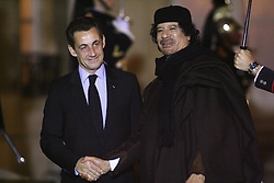 File photo - President Nicolas Sarkozy receives Libyan leader Moammar Gadhafi prior to a dinner at the Elysee Palace in Paris, France on December 10, 2007, and a signing ceremony. Gadhafi is on a 5-Day State Visit to France for a high-profile visit set to usher in multi-billion-euro nuclear and aviation contracts. Former French President Nicolas Sarkozy was in police custody on Tuesday morning March 20, 2018, an official in the country's judiciary said. He was to be questioned as part of an investigation into suspected irregularities over his election campaign financing, the same source added. The probe related to alleged Libyan funding for Sarkozy's 2007 campaign, Le Monde newspaper reported. Photo by Abd Rabbo-Mousse/ABACAPRESS.COM