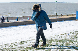 © Licensed to London News Pictures 13/02/2021.        Southend, UK. A man wearing a warm winter coat near Chalkwell Beach in freezing cold windy weather condition in Southend-on-Sea, Essex. Photo credit:Grant Falvey/LNP