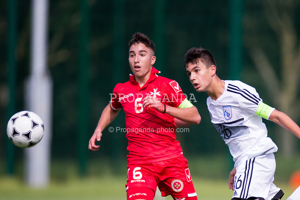 WREXHAM, WALES - Thursday, August 15, 2019: Cyprus' Michael Chiromerides and Malta's captain Kian Leonardi during the UEFA Under-15's Development Tournament match between Cyprus and Malta at Colliers Park. (Pic by Paul Greenwood/Propaganda)