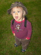 two-year-old Talus Book clowns with his hands in his pockets.