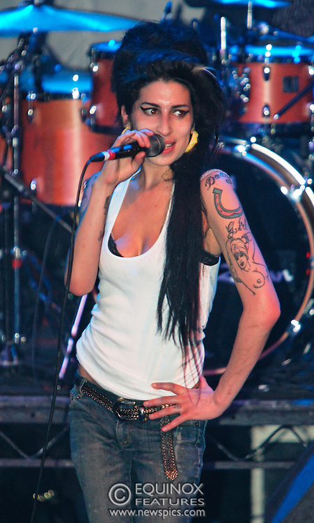 Singer Amy Winehouse, DOB=14/09/1983, performing for her gay fans at the G-A-Y Club. G-A-Y is London's biggest gay club and is held at the London Astoria nightclub, Soho, London, UK. Amy spent much of the show rubbing her itchy nose. She also seemed to have signs of old scars all down one arm...Picture Data:.Photographer: Edward Hirst.Copyright: ©2007 Licensed to Equinox News Pictures +448700 780000.Contact: Equinox Features.Date Taken: 20070415.Time Taken: 015233+0000.www.newspics.com