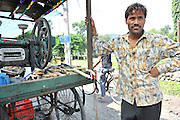 India, the Andaman and Nicobar Islands portrait of a man at his sugar cane squeezing stall