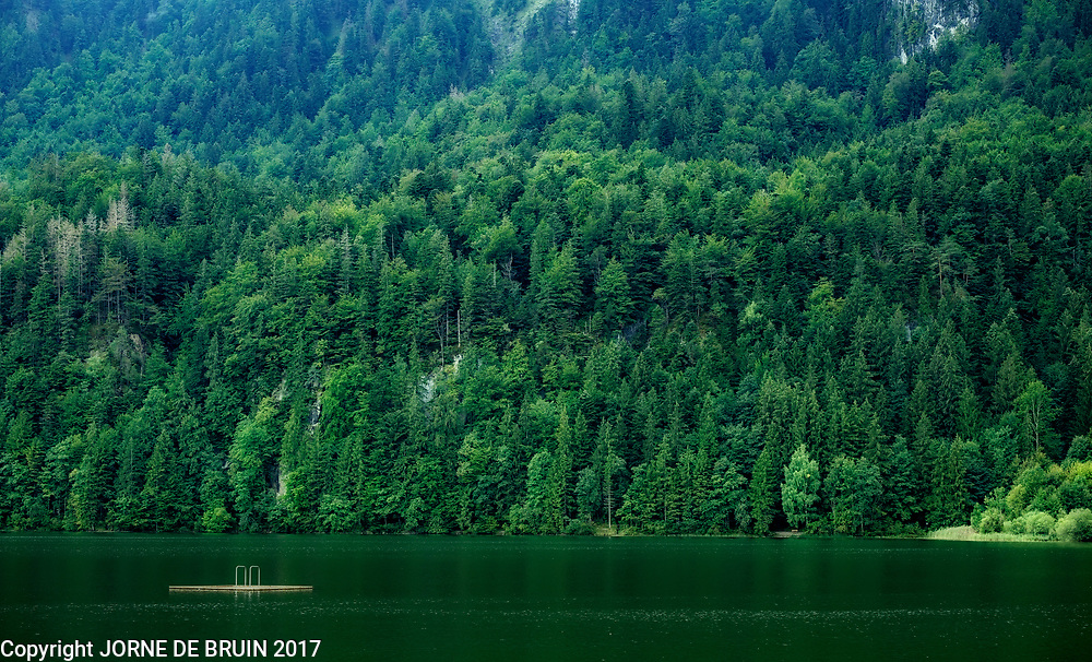 A lake set against a wooded slope in Bavaria