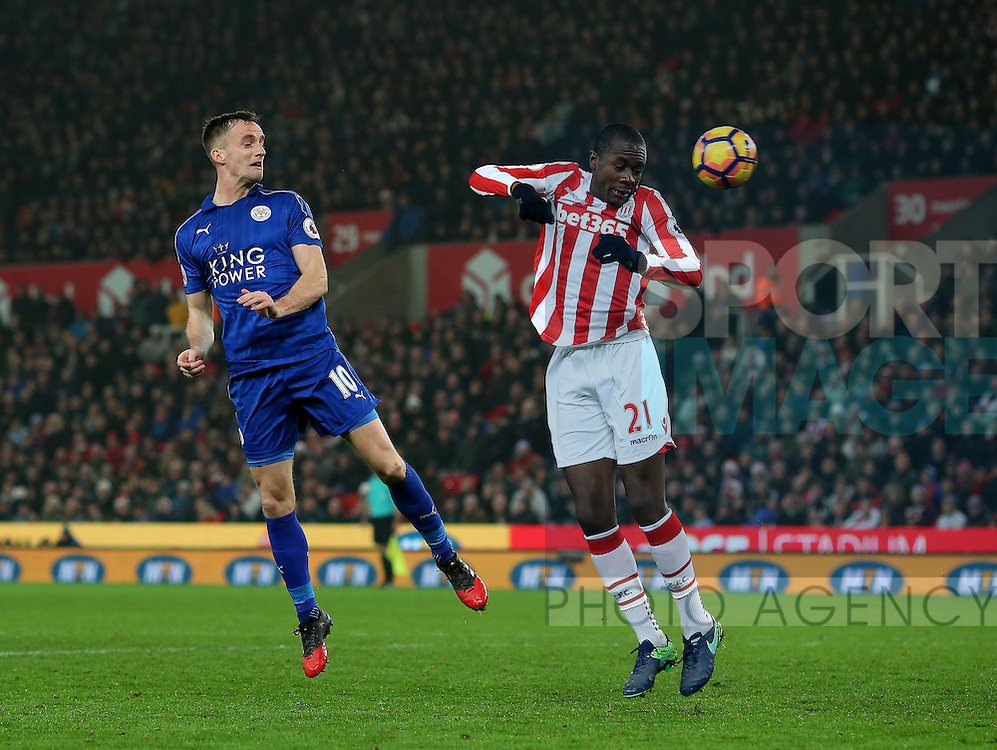 Andy King of Leicester City heads past Gianelli Imbula of Stoke City  during the English Premier League match at the Bet 365 Stadium, Stoke on Trent. Picture date: December 17th, 2016. Pic Simon Bellis/Sportimage
