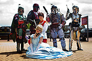 Florence Roseberry-Haynes (Cinderella) with Olivia Braddock (Prince Charming) with Mandalorian Mercs (Starwars) attending the London Film and Comic Con LFCC is a convention held annually in London that focuses on films, cult television and comics. The convention holds a large dealers hall selling movie, comic and science fiction related memorabiliaand original film props, along with free guest talks, professional photoshoots, autograph sessions, displays. Many of the visitors / attendeesarrive dressed up as their favourite comic and sci-fi characters in the most outlandish costumes which draws from the award-winning formula of innovative gameplay.