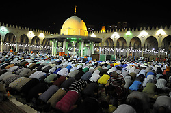 June 21, 2017 - Cairo, Egypt - Tarawih prayers on the occasion of Laylat al-Qadr which falls on the 27th day of the fasting month of Ramadan, at Cairo's historic Amr Ibn Al-A'as mosque late on June 27, 2017. (Credit Image: © Mohamed Mostafa/NurPhoto via ZUMA Press)
