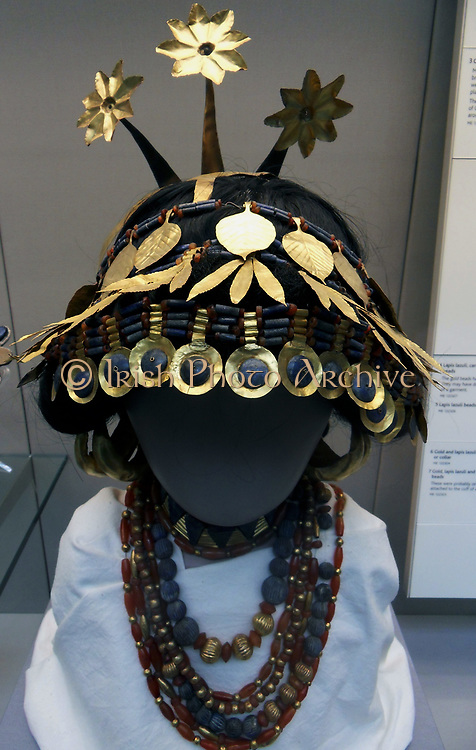 Elaborate headdress of a high-level Sumerian woman, possibly a queen or a priesless. From the royal death pits at Ur, ca. 2600 BC, now on display in the British Museum. It is made of gold, lapis lazuli and carnelian
