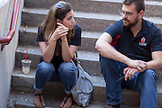Monica Nezzer and Patrick Arite wait for an introduction to the group of prospective students to which they are to give a tour on Thursday June 2, 2016. Nezzer and Arite are both students at the University of New Mexico and are working 15-30 hours per week giving campus tours in order to help put themselves through college. (Steven St. John for NPR)