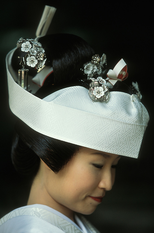 Japanese bride in traditional costume at her Shinto wedding at Kamigamo-jinja Shrine in Kyoto, Japan.