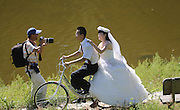 BEIJING, CHINA - AUGUST 18: (CHINA OUT) <br /> <br /> Group Wedding In Beijing<br /> <br /> Sixteen young couples hold a group cycling wedding in the suburban Yanqing county on August 18, 2013 in Beijing, China. All the brides and grooms were college graduates who voluntarily served as village officials in remote townships. <br /> ©exclusivepix