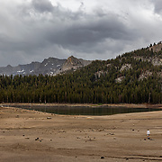 A late afternoon thunderstorm drops much needed precipitation on Horseshoe Lake that has shrunk to precarious levels in July, 2021 due to a prolonged drought.