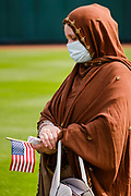 17 SEPTEMBER 2020 - DES MOINES, IOWA: SAIMA ANWARY, originally from Afghanistan, during a naturalization ceremony at Principal Park, a minor league baseball stadium in downtown Des Moines. About 75 people from 32 countries were naturalized as US citizens Thursday. It was the last citizenship ceremony in Des Moines before citizenship fees dramatically increase. Starting Oct. 2, the fee to apply for U.S. citizenship will increase from $640 to $1,160 if filed online, or $ 1,170 in paper filing, a more than 80% increase in cost. Advocates for immigration are afraid the new fees will be too expensive for many immigrants and say it's an effort by the Trump Administration to limit the number of new citizens welcomed into the United States. Because of the COVID-19 pandemic, there has been dramatic slow down in the number of naturalization ceremonies this year.        PHOTO BY JACK KURTZ