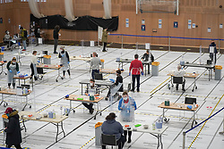 © Licensed to London News Pictures. 30/11/2020. Hull, UK. Students taking part  in a mass lateral flow Covid-19 testing set up at the University of Hull's Sports Centre, as a part of the British government's continuing drive to widely increase the availability of mass testing, ahead of students returning home for Christmas. <br /> Hull is the area which has been worst hit by the second wave of the coronavirus pandemic. Photo credit: Ioannis Alexopoulos/LNP