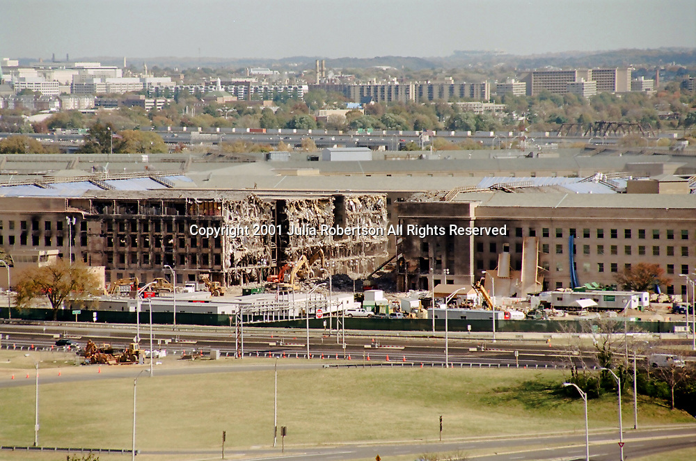 view of the Pentagon a week after September 11, 2001, image shows where Airplane entered building.<br /> <br /> From Navy Annex across street