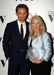 Tom Hiddleston presented Amanda Nevill with the Barclays business award at the Women in Film & TV Awards at the Hilton hotel in central London.
