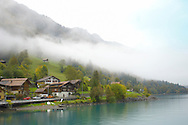 Interlaken Bernese Alps Switzerland - Lake & houses with low clouds .<br /> <br /> Visit our SWITZERLAND  & ALPS PHOTO COLLECTIONS for more  photos  to browse of  download or buy as prints https://funkystock.photoshelter.com/gallery-collection/Pictures-Images-of-Switzerland-Photos-of-Swiss-Alps-Landmark-Sites/C0000DPgRJMSrQ3U