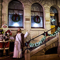 """Michael Grant, 28, """"Philly Jesus,"""" poses for a portrait beside a sculpture of Santa Claus in Philadelphia, PA on December 14, 2014.  Nearly everyday for the last 8 months, Grant has dressed as Jesus Christ, and walked the streets of Philadelphia to share the Christian gospel by example.  He quickly acquired the nickname of """"Philly Jesus,"""" which he has gone by ever since."""
