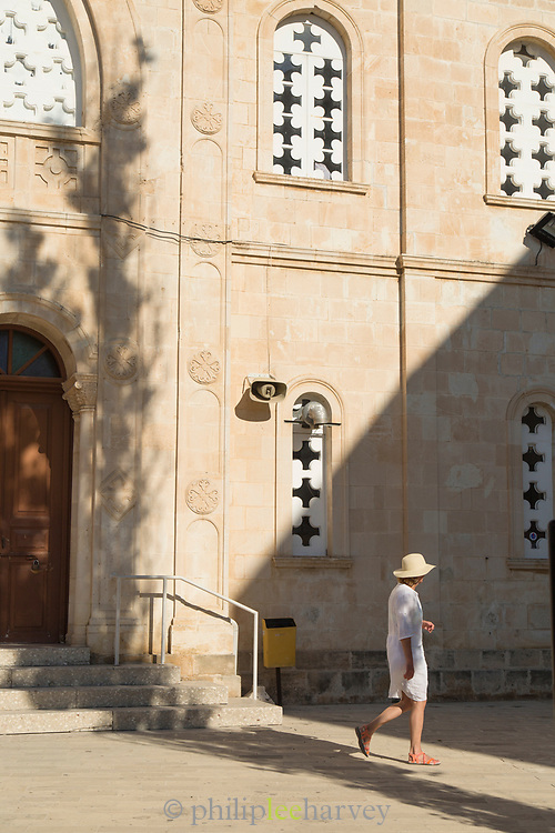 Exterior of church with tourist walking on sidewalk, Paphos, Cyprus