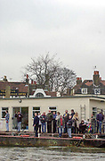 Putney. London.  2004 University Boat Race,  Championships Course, Putney to Mortlake. <br /> Spectators watch the  Oxford and Cambridge, boat race, from the Dove Pier,  Hammersmith .  <br /> <br /> [Mandatory Credit Peter SPURRIER]