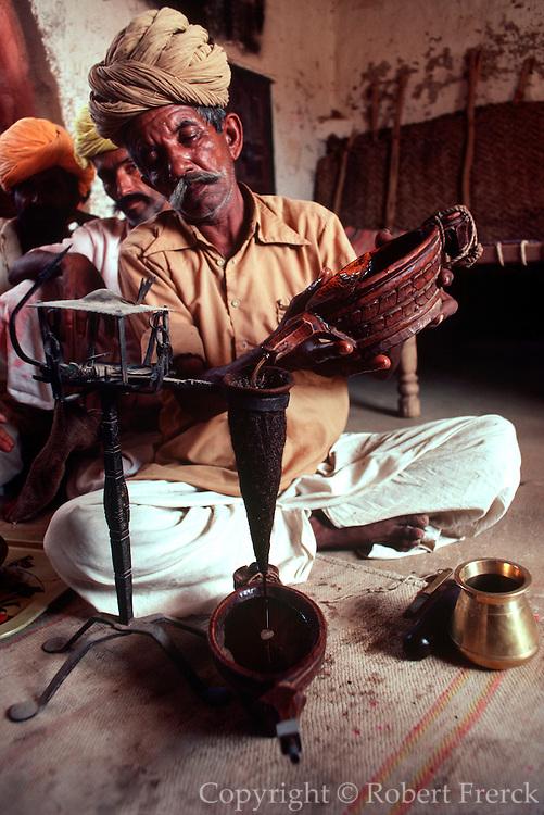 INDIA, HINDUISM, CEREMONIES opium drinking at Rajasthani wedding