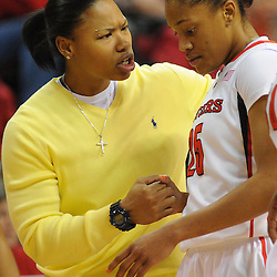 Injured Rutgers Scarlet Knights guard Khadijah Rushdan (in yellow) encourages guard Briyona Canty (25) during a first half timeout in NCAA Big East women's basketball action between Notre Dame and Rutgers at the Louis Brown Athletic Center. Notre Dame leads 40-23 at halftime.