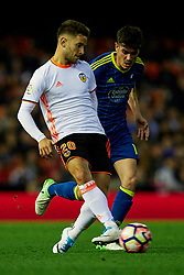 April 6, 2017 - Valencia, Valencia, Spain - Alvaro Medran (L) of Valencia CF competes for the ball with Jozabed of Real Club Celta de Vigo during the La Liga match between Valencia CF and Real Club Celta de Vigo at Mestalla Stadium on April 6, 2017 in Valencia, Spain. (Credit Image: © David Aliaga/NurPhoto via ZUMA Press)