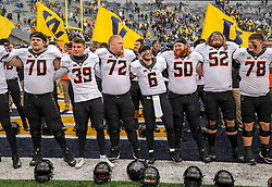 Nov 23, 2019; Morgantown, WV, USA; Oklahoma State Cowboys players celebrate after defeating the West Virginia Mountaineers at Mountaineer Field at Milan Puskar Stadium. Mandatory Credit: Ben Queen-USA TODAY Sports