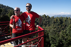 Jonathan Pite and Sean Lichter on the patio of our inn near the village of Daman where we spent our first night in the mountains after day-1 of our Himalayan Heroes adventure riding from Kathmandu to Daman, Nepal. The view took in from Dhaulagiri in the west to Mount Everest in the east. Tuesday, November 6, 2018. Photography ©2018 Michael Lichter.