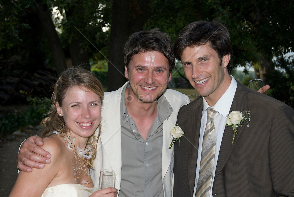 bride and groom and the best man