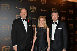 Left to right, the HON.HARRY HERBERT,LAURENT FENIOU MD of Cartier UK and his wife CARINE FENIOU at the 26th Cartier Racing Awards held at The Dorchester, Park Lane, London on 8th November 2016.
