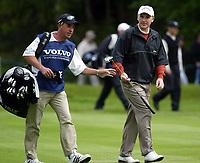 Photograph: Scott Heavey<br />Volvo PGA Championship At Wentworth Club. 23/05/2003.<br />Phillip Price with caddie.