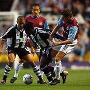 l-r; Newcastle United's Olivier Bernard is tackled by West Ham United's Sebastian Schemel