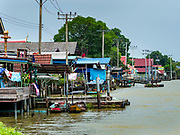 02 AUGUST 2018 - PAK KRET, NONTHABURI, THAILAND: The north shore of Ko Kret island. Ko Kret (also spelled Koh Kret) is a small island in the Chao Phraya River in Nonthaburi province north of Bangkok. It is about 2 km long and 1 km wide. It has seven main villages, the largest and most populous being Ban Mon. Ko Kret was created in 1722 when a canal was dug in the Chao Phraya River to bypass a bend. Most of the people on the island are ethnically Mon, from the hills of western Thailand and eastern Myanmar (Burma). The island is popular as a weekend daytrip from Bangkok. The island is famous for the Mon style pottery made on the island.      PHOTO BY JACK KURTZ