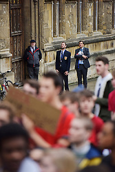 © Licensed to London News Pictures. 06/11/15 Oriel Square Oxford. UK. Article College security look on. Protest for the removal of the statue of Cecil Rhodes which is in the front of Oriel College Oxford.. Photo credit : MARK HEMSWORTH/LNP