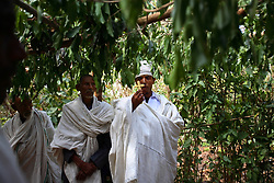 Priest Nigatu peforms the marriage of Tsegaya, 13, and Talema, 23, in Yeganda Village, Amhara Region, Ethiopia on May 20, 2007. The practice of early marriage remains widespread in Ethiopia, especially in the northern Amhara and Tigray regions, where parents consent to their daughters' consummated marriages when they are still as young as 10 or 12. In Amhara, 50 percent of girls are married by the age of 15, despite the enactment in 2000 of the revised Family Law, which sets the legal age for marriage at 18.