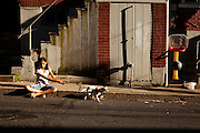 BETHLEHEM, PA – JUNE 2, 2011: Annelisses Tejada, age 10, looks after her chihuaha, Buster, at the junction of Mechanic and State Street.<br /> <br /> As the population of second and third generation Hispanics increases dramatically in the United States, a new boldness can be sensed among Latinos in America, stretching far beyond the southern border states. Demographers in Pennsylvania say the towns of Bethlehem, Allentown and Reading are set to become majority-minority cities, where Hispanics comprise a bigger portion of the population than whites. As this minority population increases dramatically in the region, Latinos are inching closer to their own realization of the American Dream, while gradually shifting the physical and cultural landscapes of their communities.