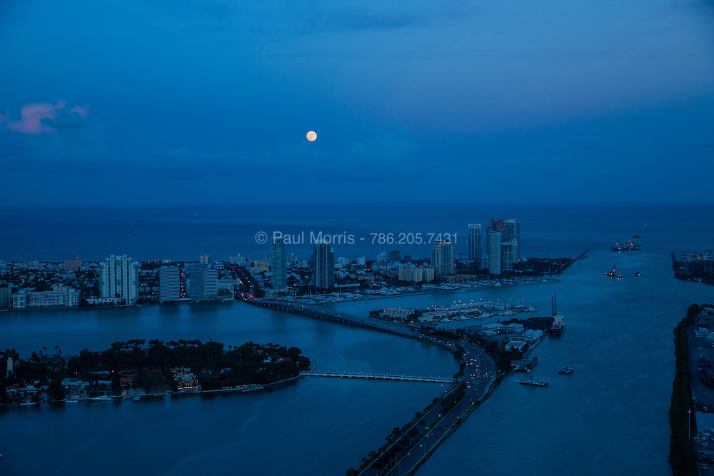 Moon rise over Miami Beach with Government Cut and South Beach and South Pointe Park and MacArthur Causeway