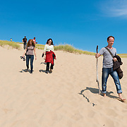 People Walking on Parabolic Dunes of Cape Cod
