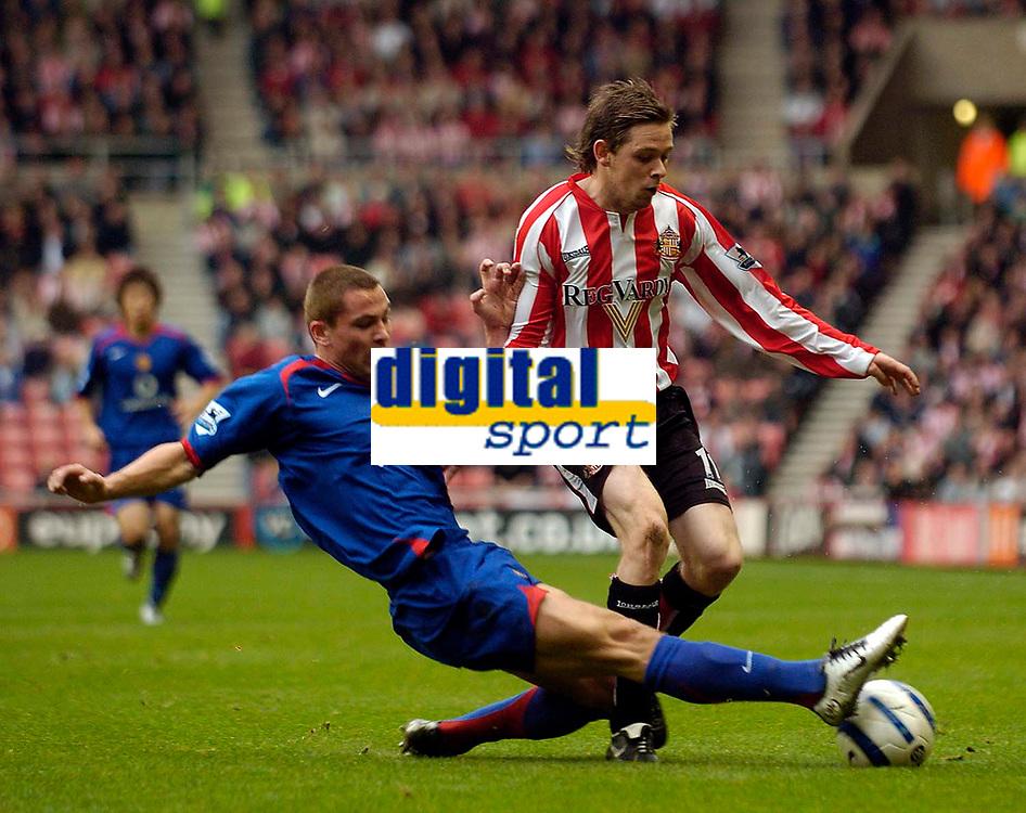 Photo: Jed Wee.<br />Sunderland v Manchester Utd. The Barclays Premiership. 15/10/2005.<br /><br />Sunderland's Andy Welsh (R) is tackled by Manchester United's Phil Bardsley.