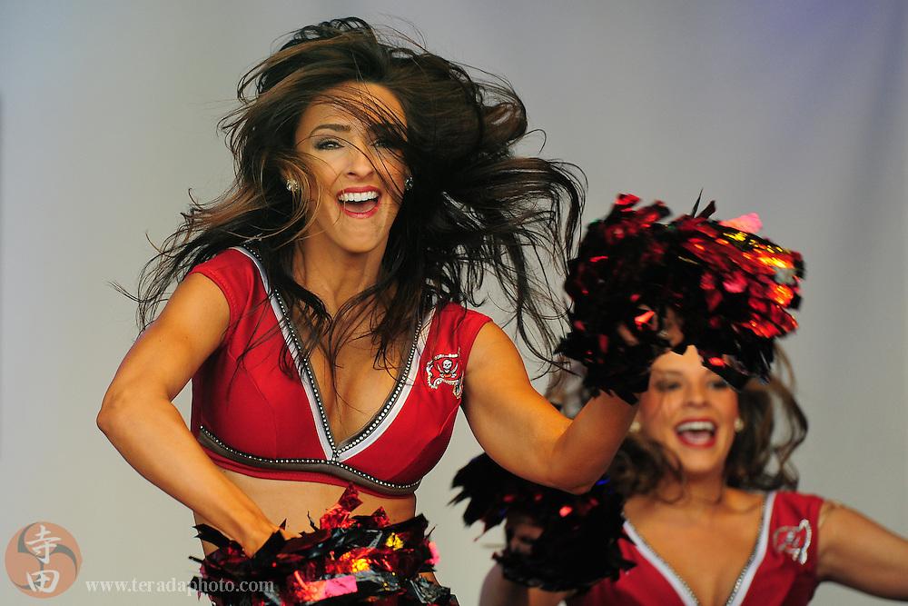 October 22, 2011; London, ENGLAND; Tampa Bay Buccaneers cheerleader Ashley Jarocki performs during the 2011 NFL International Series fan rally at Trafalgar Square.