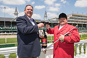 Keith Kenison, 14 Hands winemaker, left, and the official bugler, Steve Buttleman, toast the commemorative 14 Hands Limited Release Kentucky Derby Red Blend wine, on Wednesday, Apr. 29, 2015, in front of the Twin Spires at Churchill Downs in Louisville, Ky. (Photo by Brian Bohannon/Invision for 14 Hands Winery/AP Images)