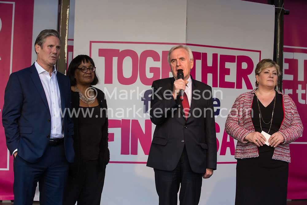 London, UK. 19 October, 2019. John McDonnell, Shadow Chancellor, seen here with Shadow Brexit Secretary Sir Keir Starmer, Shadow Home Secretary Diane Abbott and Shadow Foreign Secretary Emily Thornberry, addresses hundreds of thousands of pro-EU citizens at a Together for the Final Say People's Vote rally in Parliament Square as MPs meet in a 'super Saturday' Commons session, the first such sitting since the Falklands conflict, to vote, subject to the Sir Oliver Letwin amendment, on the Brexit deal negotiated by Prime Minister Boris Johnson with the European Union.